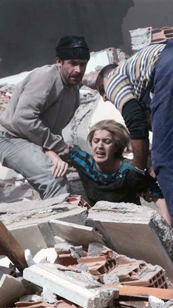 People rescue a woman trapped under debris after a powerful 7.2-magnitude earthquake struck eastern Turkey, collapsing about 45 buildings in Van province, Sunday, Oct. 23, 2011 according to the deputy Turkish prime minister. Only one death was immediately confirmed, but scientists estimated that up to 1,000 people could have been killed. The worst damage was caused to the town of Ercis, in the mountainous eastern province of Van, close to the Iranian border. &#40; AP Photo&#47; Ali Ihsan Ozturk, Aatolia&#41; TURKEY OUT <span class=meta>(AP Photo&#47; Ali Ihsan Ozturk)</span>