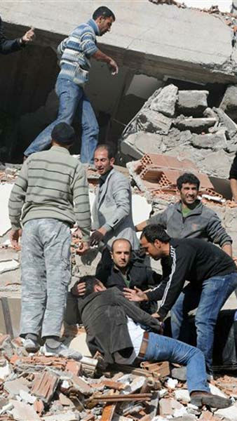People try to save people trapped under debris in Tabanli village near the city of Van after a powerful earthquake struck eastern Turkey Sunday Oct. 23, 2011, collapsing some buildings and causing a number of deaths, an official said. &#40; AP Photo&#47; Abdurrahman Antakyali, Aatolia&#41; TURKEY OUT <span class=meta>(AP Photo&#47; Abdurrahman Antakyali)</span>