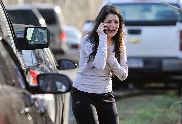 "<div class=""meta ""><span class=""caption-text "">A woman waits to hear about her sister, a teacher, following a shooting at the Sandy Hook Elementary School in Newtown, Conn., about 60 miles (96 kilometers) northeast of New York City, Friday, Dec. 14, 2012. An official with knowledge of Friday's shooting said 27 people were dead, including 18 children. It was the worst school shooting in the country's history. (AP Photo/Jessica Hill)</span></div>"