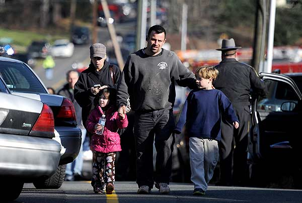 "<div class=""meta image-caption""><div class=""origin-logo origin-image ""><span></span></div><span class=""caption-text"">Parents leave a staging area after being reunited with their children following a shooting at the Sandy Hook Elementary School in Newtown, Conn., about 60 miles (96 kilometers) northeast of New York City, Friday, Dec. 14, 2012. An official with knowledge of Friday's shooting said 27 people were dead, including 18 children. It was the worst school shooting in the country's history. (AP Photo/Jessica Hill)</span></div>"