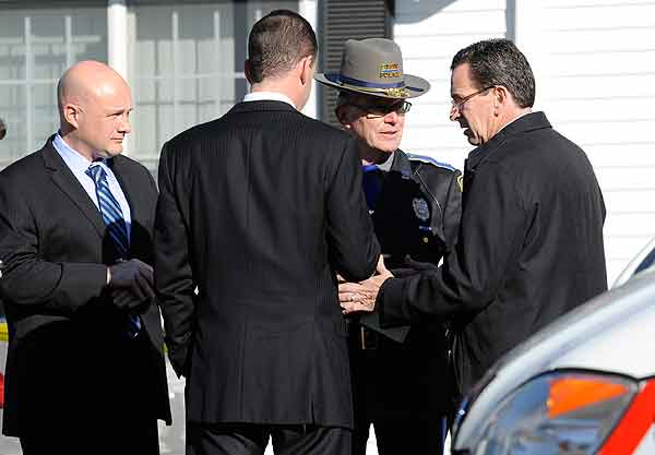 "<div class=""meta ""><span class=""caption-text "">Gov. Dannel P. Malloy, right, talks with officials at a staging area following a shooting at the Sandy Hook Elementary School in Newtown, Conn., about 60 miles (96 kilometers) northeast of New York City, Friday, Dec. 14, 2012. An official with knowledge of Friday's shooting said 27 people were dead, including 18 children. (AP Photo/Jessica Hill)</span></div>"