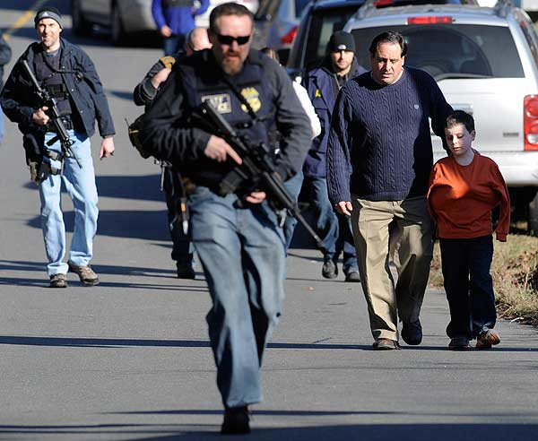 "<div class=""meta ""><span class=""caption-text "">Parents leave a staging area after being reunited with their children following a shooting at the Sandy Hook Elementary School in Newtown, Conn., about 60 miles (96 kilometers) northeast of New York City, Friday, Dec. 14, 2012. An official with knowledge of Friday's shooting said 27 people were dead, including 18 children. It was the worst school shooting in the country's history. (AP Photo/Jessica Hill)</span></div>"