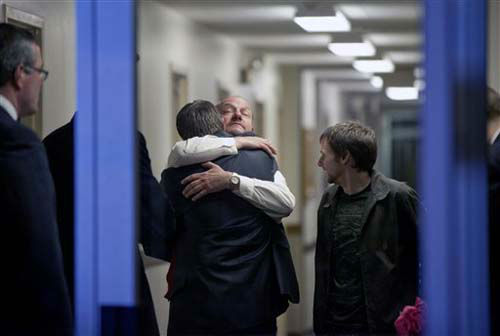 Randy Parker, facing camera, embraces his son Robbie Parker, the father of six-year-old Emilie who was killed in the Sandy Hook Elementary School shooting, before he addresses the media on the death of his daughter at a news conference, Saturday, Dec. 15, 2012, in Newtown, Conn. &#40;AP Photo&#47;David Goldman&#41; <span class=meta>(Photo&#47;David Goldman)</span>