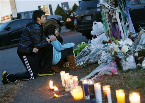Mourners pay their respects at a memorial for shooting victims near Sandy Hook Elementary School, Saturday, Dec. 15, 2012 in Newtown, Conn.  A gunman walked into Sandy Hook Elementary School in Newtown Friday and opened fire, killing 26 people, including 20 children. &#40;AP Photo&#47;Jason DeCrow&#41; <span class=meta>(Photo&#47;Jason DeCrow)</span>