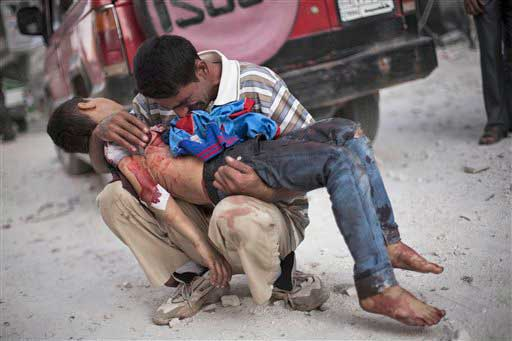 In this Wednesday, Oct. 3, 2012 photo, a Syrian man cries while holding the body of his son killed by the Syrian Army near Dar El Shifa hospital in Aleppo, Syria.  <span class=meta>(AP photo)</span>