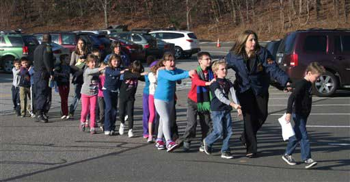 In this photo provided by the Newtown Bee, Connecticut State Police lead a line of children from the Sandy Hook Elementary School in Newtown, Conn. on Friday, Dec. 14, 2012 after a shooting at the school.  <span class=meta>(AP photo)</span>