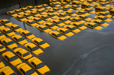 In this Tuesday, Oct. 30, 2012 file photo, a parking lot full of yellow cabs is flooded as a result of Superstorm Sandy in Hoboken, NJ.   <span class=meta>(AP photo)</span>