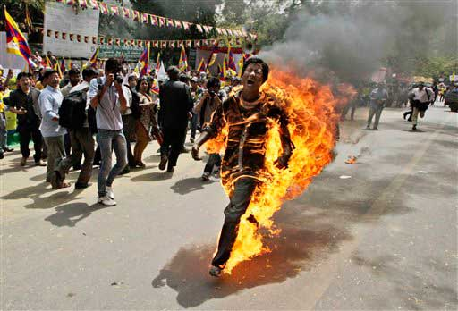 In this March 26, 2012 file photo, Tibetan exile Jamphel Yeshi screams as he runs engulfed in flames after setting himself on fire at a protest in New Delhi, India, against Chinese President Hu Jintao&#39;s visit to India. Yeshi died Wednesday, March 28, 2012.  <span class=meta>(AP photo)</span>