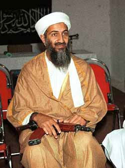 "<div class=""meta ""><span class=""caption-text "">Exiled al Qaida leader Osama bin Laden, the prime suspect behind the Sept. 11, 2001 terrorist attacks in the United States, holds a Kalashnikov assault rifle in 1998 at a meeting at an undisclosed location in Afghanistan, according to the source. In the background is a banner with a verse from the Quran, Islam's holy book. This photo was offered to The Associated Press on Sept. 22, 2001, by a Pakistani photographer who wishes to remain anonymous. (AP Photo) (AP Photo/ Anonymous)</span></div>"
