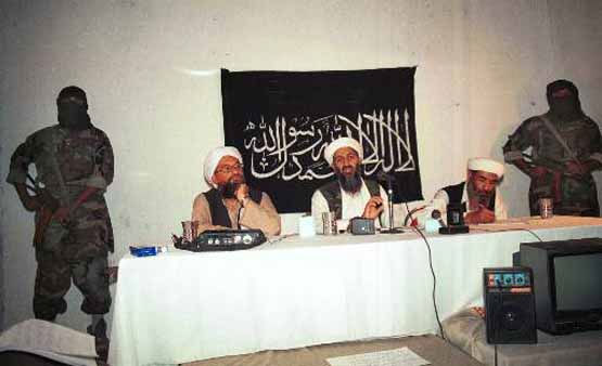 This is a 1998 photo showing exiled   al Qaida leader Osama bin Laden, center, the prime suspect behind the Sept. 11, 2001 terrorist attacks in the United States, flanked by his aides and armed bodyguards in a meeting at an undisclosed location in Afghanistan, according to the source. In the background is a banner with a verse from the Quran, Islam&#39;s holy book. This photo was offered to the Associated Press on Sept. 22, 2001 from a Pakistani photographer who wants to remain anonymous. &#40;AP Photo&#41; <span class=meta>(AP Photo&#47; Anonymous)</span>