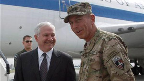 U.S. Secretary of Defense Robert Gates is greeted upon his arrival in Kabul by U.S. General David Petraeus, right, Commander of Intern