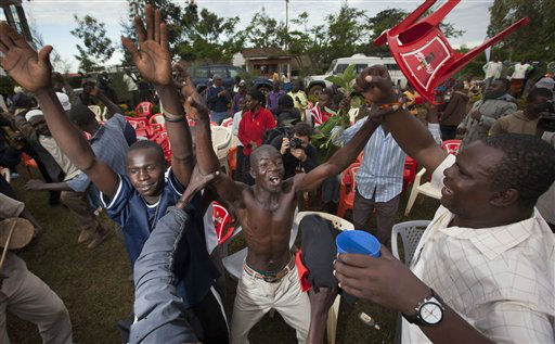 "<div class=""meta ""><span class=""caption-text "">Villagers at an all-night party to watch the U.S. presidential election celebrate after a television station called the result in favor of President Barack Obama, in the village of Kogelo, home to Sarah Obama the step-grandmother of President Barack Obama, in western Kenya Wednesday, Nov. 7, 2012.  (AP Photo/ Ben Curtis)</span></div>"