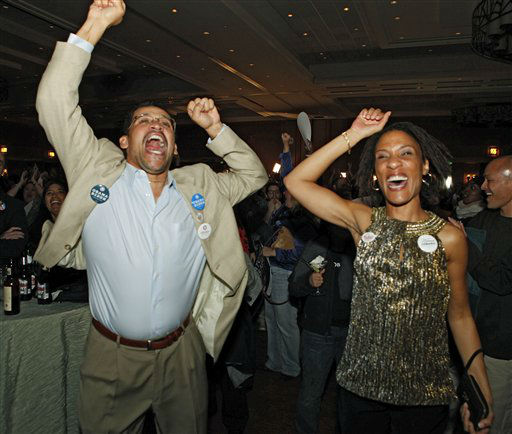 Roland and Natalie Jones celebrate as President Barack Obama is predicted as the winner over challenger Mitt Romney at a Colorado Democrat&#39;s election party at the Sheraton Hotel in Denver on Tuesday, Nov. 6, 2012.  <span class=meta>(AP Photo&#47; Ed Andrieski)</span>