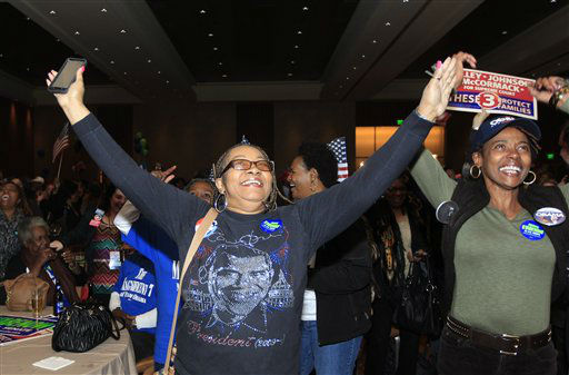Anita Flanigan, left, and Renee Drake celebrate as President Obama reaches the 270 Electoral College votes during the Michigan Democratic election night party at the MGM Grand Detroit, following Election Day, early Wednesday, Nov. 7, 2012.   <span class=meta>(AP Photo&#47; Carlos Osorio)</span>