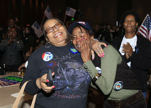 Anita Flanigan, left, and Renee Drake react after President Obama reaches the 270 Electoral College votes during the Michigan Democratic election night party at the MGM Grand Detroit, following Election Day, early Wednesday, Nov. 7, 2012.   <span class=meta>(AP Photo&#47; Carlos Osorio)</span>