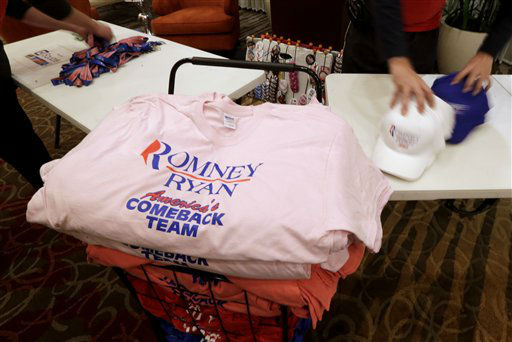 Vendors pack Romney Ryan merchandise after a watch party for U.S. Senate candidate, Rep. Todd Akin, R-Mo., Tuesday, Nov. 6, 2012, in Chesterfield, Mo. Akin lost the race to U.S. Sen. Claire McCaskill, D-Mo.   <span class=meta>(AP Photo&#47; Charlie Riedel)</span>