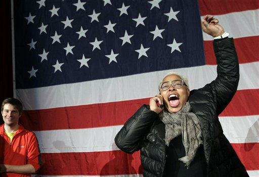 "<div class=""meta ""><span class=""caption-text "">President Barack Obama supporter Lisette Drumgold celebrates on the stage at New York State Democratic Headquarters following Election Day, Tuesday, Nov. 6, 2012. (AP Photo/Kathy Willens) (AP Photo/ Kathy Willens)</span></div>"