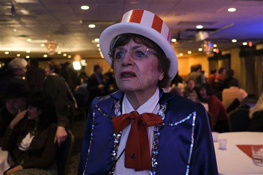Loris Tangvik, a supporter of former Massachusetts Gov. Mitt Romney, reacts as she watches the election results at the election night event for Rep. Denny Rehberg, R-Mont., in Billings, Mont., Tuesday, Nov. 6, 2012. &#40;AP Photo&#47;Jae C. Hong&#41; <span class=meta>(AP Photo&#47; Jae C. Hong)</span>