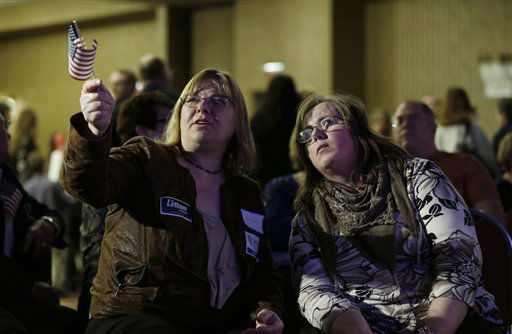 Christy Grubbs, of Casey, Iowa, left, and Lori Wanninger, of Audubon, Iowa, supporters for Republican presidential candidate Mitt Romney, react as election results are announced during an Iowa Republican party election night rally, Tuesday, Nov. 6, 2012, in Des Moines, Iowa. &#40;AP Photo&#47;Charlie Neibergall&#41; <span class=meta>(AP Photo&#47; Charlie Neibergall)</span>