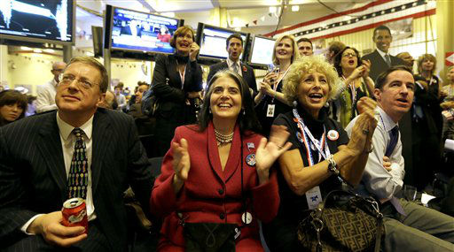 Angelique Fernandez of New York, second from right, with her friend Sidney Ross, second from left, both supporting President Barack Obama react to early election results during the Presidential Election party at the U.S. Embassy in London, Wednesday, Nov.  7, 2012. &#40;AP Photo&#47;Alastair Grant&#41; <span class=meta>(AP Photo&#47; Alastair Grant)</span>