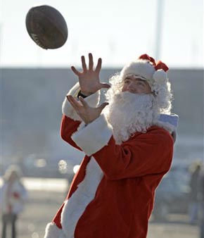 Mike Rottger, dressed as Santa Claus, catches a football while tailgating prior to the Buffalo Bills and Denver Broncos NFL football game in Orchard Park, N.Y., Saturday, Dec. 24, 2011. &#40;AP Photo&#47;Gary Wiepert&#41; <span class=meta>(AP Photo&#47; Gary Wiepert)</span>