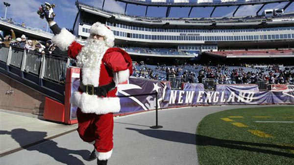 A man dressed as Santa Claus waves to fans arriving at Gillette Stadium to watch the New England Patriots play the Miami Dolphins at an NFL football game at in Foxborough, Mass. Saturday, Dec. 24, 2011. &#40;AP PhotoElise Amendola&#41; <span class=meta>(AP Photo&#47; Elise Amendola)</span>