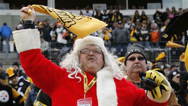 A Pittsburgh Steelers fan dressed in a Santa Claus coat twirls his Terrible Towel before the start of the NFL football game between the Pittsburgh Steelers and the St. Louis Rams on Saturday, Dec. 24, 2011 in Pittsburgh. &#40;AP Photo&#47;Keith Srakocic&#41; <span class=meta>(AP Photo&#47; Keith Srakocic)</span>