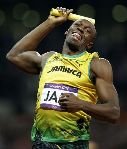 Jamaica's Usain Bolt celebrates as he finishes first in the men's 4 x 100-meter relay during the athletics in the Olympic Stadium at the 2012 Summer Olympics, London, Saturday, Aug. 11, 2012. Jamaica set a new world record with a time of 36.84 seconds.(AP Photo/Lee Jin-man)