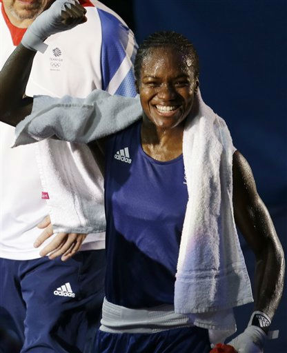 Great Britain's Nicola Adams celebrates winning her gold medal match against China's Ren Cancan, during women's flyweight 51-kg boxing at the 2012 Summer Olympics, Thursday, Aug. 9, 2012, in London. (AP Photo/Patrick Semansky)