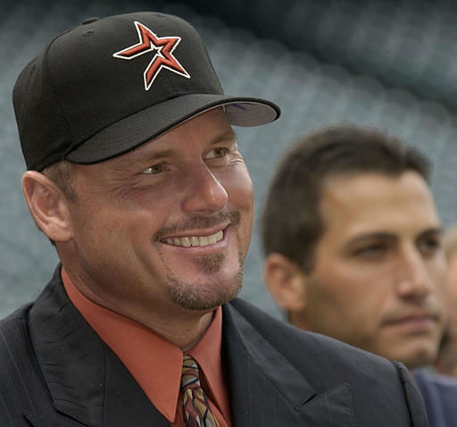 Former New York Yankee pitcher Roger Clemens, left, and Andy Pettitte, right, listen during a news conference with the Houston Astros Monday, Jan. 12, 2004 in Houston. Clemens is pushing back his retirement, agreeing to a one-year contract with the Astros. &#40;AP Photo&#47;David J. Phillip&#41; <span class=meta>(AP Photo&#47; DAVID J. PHILLIP)</span>