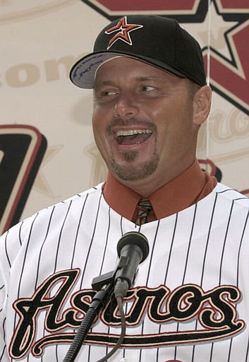 Former New York Yankee pitcher Roger Clemens laughs as he answers a question during a news conference with the Houston Astros Monday, Jan. 12, 2004 in Houston. Clemens is pushing back his retirement, agreeing to a one-year contract with the Astros. &#40;AP Photo&#47;David J. Phillip&#41; <span class=meta>(AP Photo&#47; DAVID J. PHILLIP)</span>