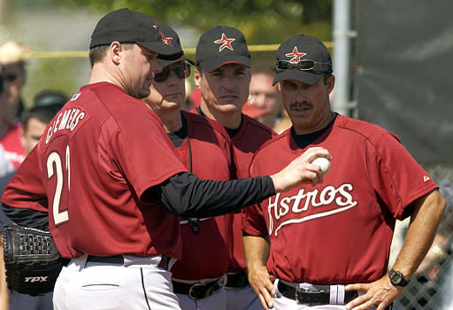 From left, Houston Astros pitcher Roger Clemens talks about his pitching with Astros pitching coaches Burt Hooton, Jim Hickey, and minor league pitching coordinator Dewey Robinson at spring training Sunday, Feb. 22, 2004 in Kissimmee, Fla. &#40;AP Photo&#47;Tony Dejak&#41; <span class=meta>(AP Photo&#47; TONY DEJAK)</span>