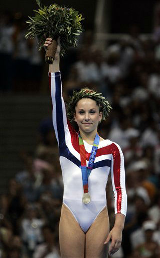 Silver-medalist Carly Patterson of the United States holds up her flowers during the medal ceremony after the balance beam during the women&#39;s gymnastics individual apparatus finals at the 2004 Summer Olympic Games in Athens, Monday, Aug. 23, 2004. &#40;AP Photo&#47;Amy Sancetta&#41; <span class=meta>(AP Photo&#47; AMY SANCETTA)</span>