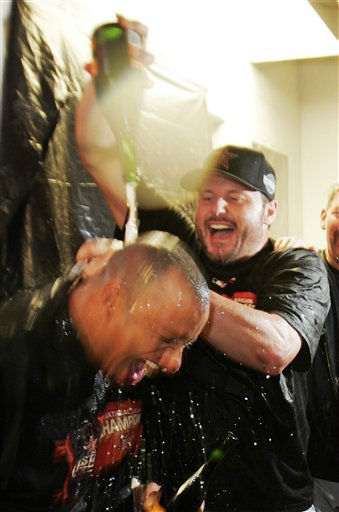 Houston Astros  pitcher Roger Clemens, right, pours champagne over Jose Vizcaino after the Astros defeated the St. Louis Cardinals 5-1 in Game 6 to win the  National League Championship pennant in St. Louis, Wednesday, Oct. 19, 2005. The Astros will play in the Chicago White Sox in the World Series.  &#40;AP Photo&#47;Mark Humphrey&#41; <span class=meta>(AP Photo&#47; MARK HUMPHREY)</span>