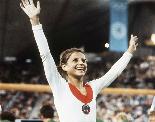 "<div class=""meta image-caption""><div class=""origin-logo origin-image ""><span></span></div><span class=""caption-text"">Olga Korbut of Russia throws up her arms in joy after winning the Individual Women's Gymnastic event at the 1972 Summer Olympics in Munich, Germany, Aug. 1972. (AP Photo) (AP Photo/ XMDB)</span></div>"
