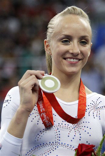 "<div class=""meta image-caption""><div class=""origin-logo origin-image ""><span></span></div><span class=""caption-text"">U.S. gymnast Nastia Liukin poses with her silver medal on the podium for the balance beam apparatus finals at the Beijing 2008 Olympics in Beijing, Tuesday, Aug. 19, 2008.  (AP Photo/Rob Carr) (AP Photo/ Rob Carr)</span></div>"