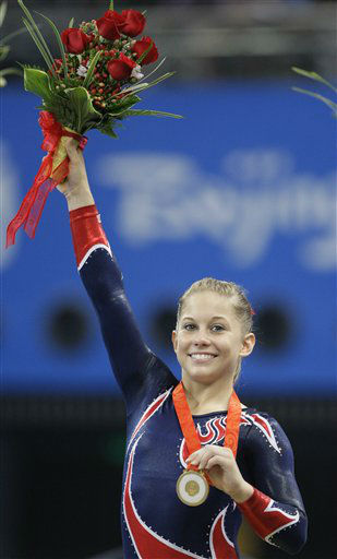 U.S. gymnast Shawn Johnson poses with her gold medal on the podium for the balance beam apparatus finals at the Beijing 2008 Olympics in Beijing, Tuesday, Aug. 19, 2008.  &#40;AP Photo&#47;Amy Sancetta&#41; <span class=meta>(AP Photo&#47; Amy Sancetta)</span>