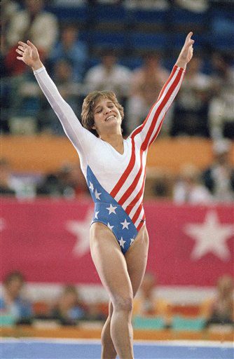 FILE -- In an August 1984 file photo Mary Lou Retton celebrates her balance beam score at the 1984 Olympic Games in Los Angeles. The 25th anniversary of the Opening Ceremonies of the Olympics in Los Angeles is on July 28th. &#40;AP Photo&#47;Lionel Cirroneau&#47;file&#41; <span class=meta>(AP Photo&#47; Lionel Cirroneau)</span>