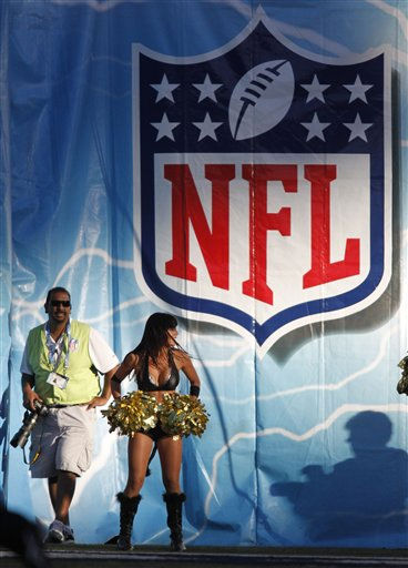 "<div class=""meta ""><span class=""caption-text "">A San Diego Chargers cheerleader in a Halloween costume during an NFL football game between the Oakland Raiders and the San Diego Chargers Sunday, Nov. 1, 2009 in San Diego.   (AP Photo/ Denis Poroy)</span></div>"