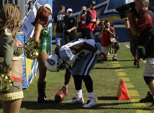 Tennessee Titans running back Chris Johnson puts the football in front of a San Diego Chargers cheerleader dressed in Halloween costume after scoring during the first half of an  NFL football game between the San Diego Chargers and Tennessee Titans Sunday, Oct. 31, 2010, in San Diego.  <span class=meta>(AP Photo&#47; Gregory Bull)</span>