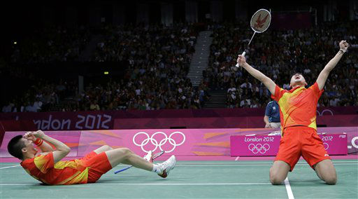 China&#39;s Fu Haifeng, left, and Cai Yun celebrate after beating Koo Kien Keat and Tan Boon Heong, of Malaysia, in a men&#39;s doubles badminton semifinal match at the 2012 Summer Olympics, Saturday, Aug. 4, 2012, in London. &#40;AP Photo&#47;Andres Leighton&#41; <span class=meta>(AP Photo&#47; Andres Leighton)</span>