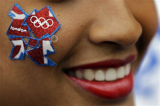 A young woman wears a London Olympics logo on her cheek outside the Olympic Park ahead of the 2012 Summer Olympics Opening Ceremony, Friday, July 27, 2012, in London.   <span class=meta>(AP Photo&#47; Matt Rourke)</span>