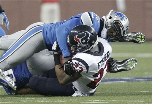 Detroit Lions outside linebacker Justin Durant &#40;52&#41; tackles Houston Texans running back Arian Foster &#40;23&#41; during the second quarter of an NFL football game at Ford Field in Detroit, Thursday, Nov. 22, 2012.   <span class=meta>(AP Photo&#47; Duane Burleson)</span>