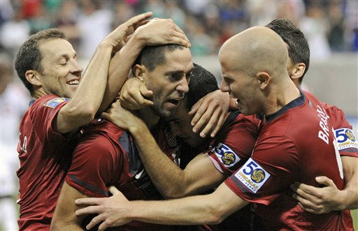 United States&#39; Clint Dempsey, center, is congratulated by teammates after scoring a goal against Panama during the second half of a CONCACAF Gold Cup semifinal soccer match Wednesday, June 22, 2011, in Houston.  <span class=meta>(AP Photo&#47; Dave Einsel)</span>