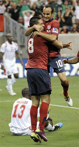 United States&#39; Clint Dempsey &#40;8&#41; celebrates with teammate Landon Donovan &#40;10&#41; after Dempsey scored a goal against Panama during the second half of a CONCACAF Gold Cup semifinal soccer match Wednesday, June 22, 2011, in Houston.  <span class=meta>(AP Photo&#47; Dave Einsel)</span>