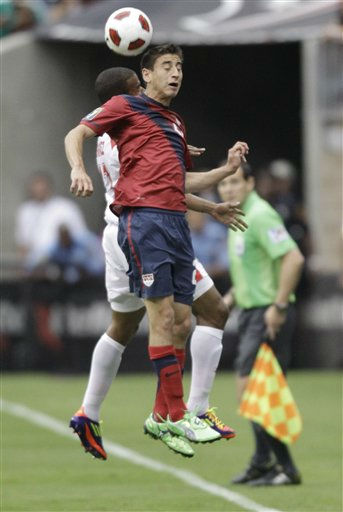United States&#39; Benny Feilhaber, front, and Panama&#39;s Luis Henriquez leap for a head ball during the first half of a CONCACAF Gold Cup semifinal soccer match Wednesday, June 22, 2011, in Houston.  <span class=meta>(AP Photo&#47; David J. Phillip)</span>