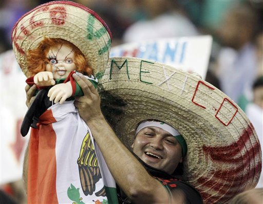 "<div class=""meta ""><span class=""caption-text "">A Mexico fan holds up a decorated doll before a CONCACAF Gold Cup semifinal soccer match between Mexico and Honduras on Wednesday, June 22, 2011, in Houston.  (AP Photo/ David J. Phillip)</span></div>"