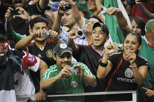"<div class=""meta image-caption""><div class=""origin-logo origin-image ""><span></span></div><span class=""caption-text"">Mexico fans take pictures before a CONCACAF Gold Cup semifinal soccer match between Mexico and Honduras on Wednesday, June 22, 2011, in Houston.  (AP Photo/ Dave Einsel)</span></div>"