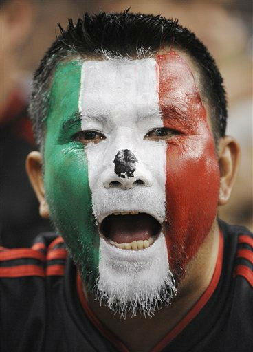 A Mexico fan cheers before a CONCACAF Gold Cup semifinal soccer match between Mexico and Honduras on Wednesday, June 22, 2011, in Houston.  <span class=meta>(AP Photo&#47; Dave Einsel)</span>