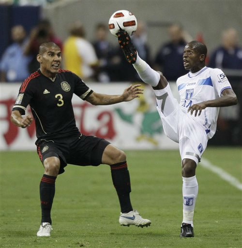Honduras&#39; Oscar Boniek Garcia goes after the ball as Mexico&#39;s Carlos Salcido defends during the first half of a CONCACAF Gold Cup semifinal soccer match Wednesday, June 22, 2011, in Houston.  <span class=meta>(AP Photo&#47; David J. Phillip)</span>